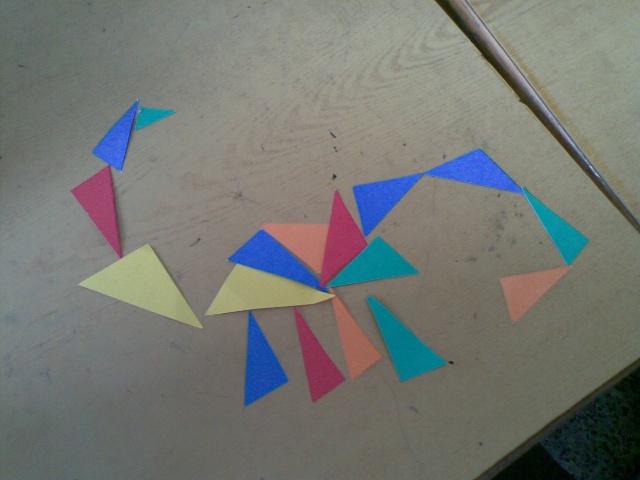 拼成的图形,三角形拼成的恐龙图形,用图形拼成的